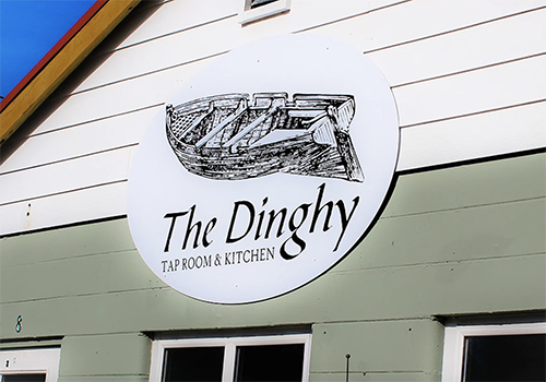 sign and logo for the dinghy restaurant
